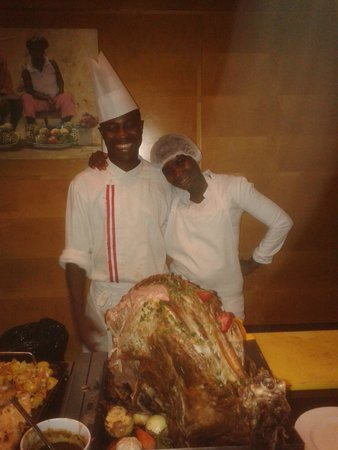 Movenpick Ambassador Hotel Accra : The friendly staff in the dining room with an entire roast something
