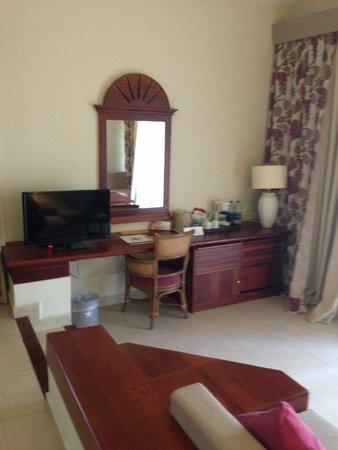 Iberostar Bavaro Suites: TV and small fridge in bottom cabinet