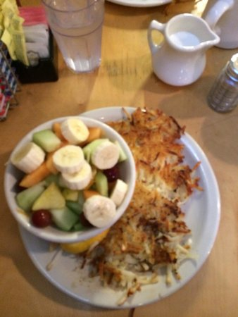 Loula's: Bowl of fruit and side of hash browns! Lots of food for a little price!