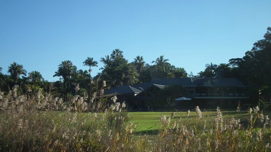 BreakFree Aanuka Beach Resort: View of main hotel building from grass in front of beach