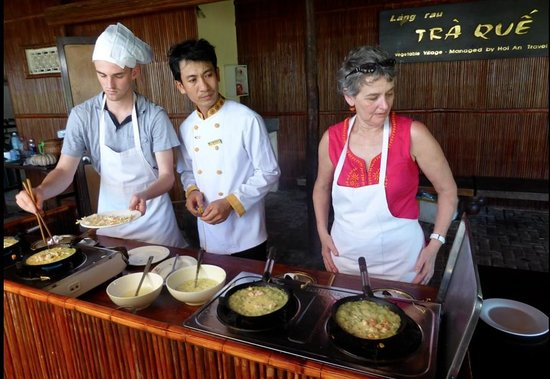 Indochina Odyssey Tours - Day Tours: Family learning to make rice pancakes