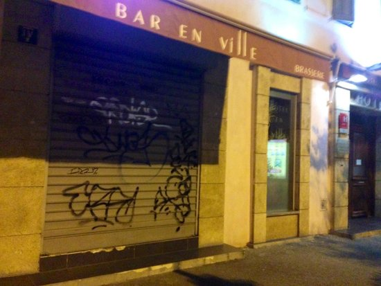 Hotel En Ville: Graffiti on metal gates over windows