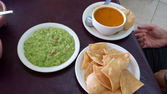 El Fogon: Chips and guac with a side of Frijoles .