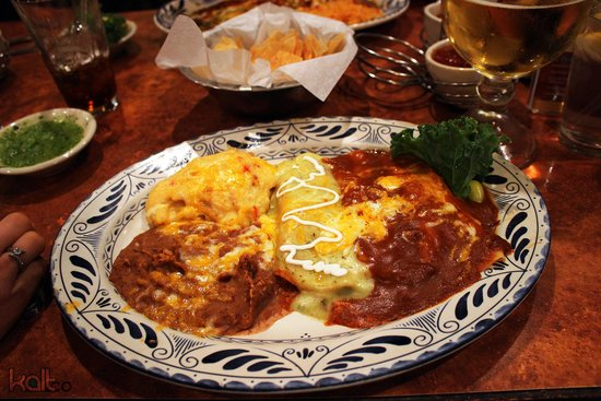 Abuelo's: Enchilada platter with refried beans and papas.