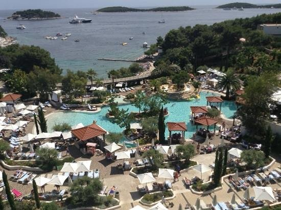 Amfora Hvar Grand Beach Resort: View of pool and beach (lane rope ocean pool in middle, town centre 10 min stroll on path to lef