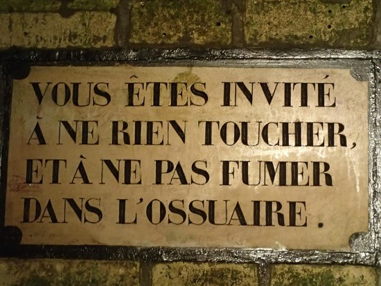 The Catacombs: Advisory to refrain from touching the bones or smoking.