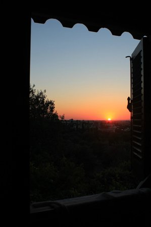 Five Fingers Holiday Bungalows: last sunset from our Window