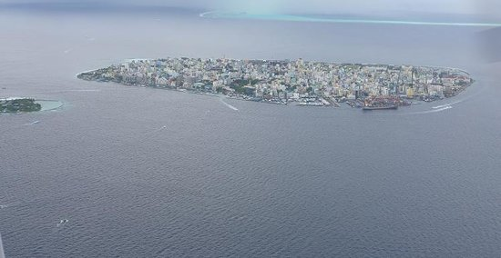 Medhufushi Island Resort: male city from jet plane view capitol city of Maldives