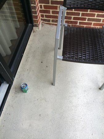 Courtyard by Marriott Newark-University of Delaware: Sprite can with discarded cigarette butts left on patio by prior guests.
