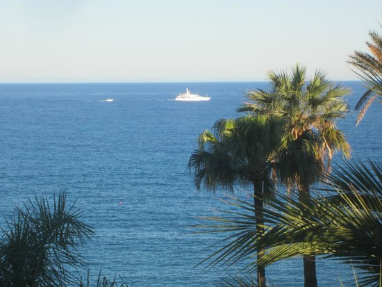 Royal Hotel Sanremo: View across the bay from our roomof one of the many yachts that go sailing by in summer...