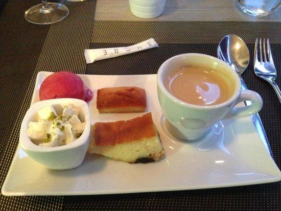 Restaurant De La Vallee : Coffee and a mixture of desserts indoors