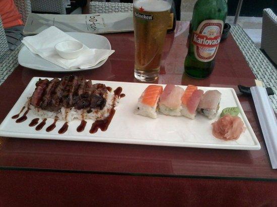 Oyster & Sushi Bar Bota : Beef teriyaki and rainbow roll.