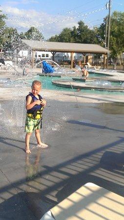 River Plantation RV Resort: my son at the pool