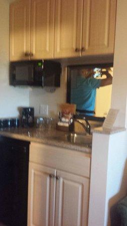Mediterranean Inn: Microwave, coffee machine, fridge, and kitchen sink
