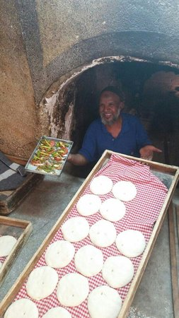 Souk Cuisine : The local baker cooking our sardines