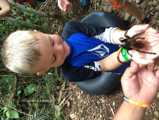 Cave Tubing with Vitalino Reyes: Holding a tarantula