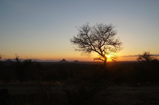 Naledi Bushcamp and Enkoveni Camp: African sunset