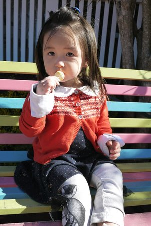 Granny Macs Fudge Store : Lil precious enjoy her lollipop freebie on the bench outside the store..