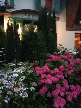 Beautiful flowers decorate the entrance of Cafe de Certoux