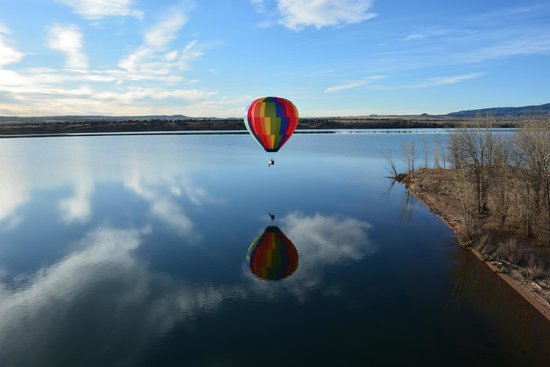Rocky Mountain Hot Air: Another balloon flying over the lake near us