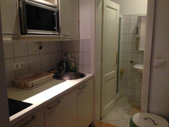 Most Hostel: キッチンと奥がトイレ浴室