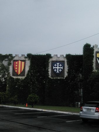 Medieval Times Dinner & Tournament: Some of the knights banners outside on the castle wall
