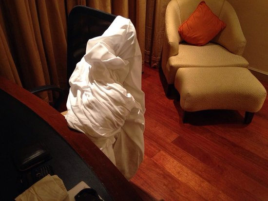 Vivanta by Taj - President, Mumbai: The bed sheet stacked away by the staff after the room was made  They forgot to take the sheet