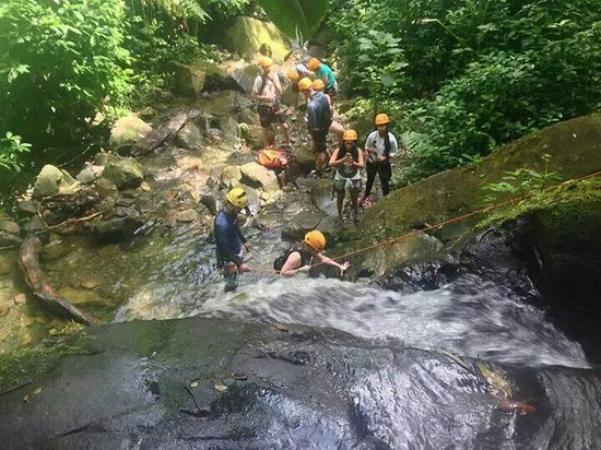 Rocaliza Adventure Tours: Rock climbing up one of the smaller waterfalls
