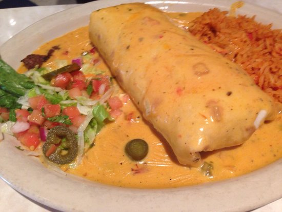 Chuy's: Burrito. Comes stuffed with beans and choice of meat and sauce on top.