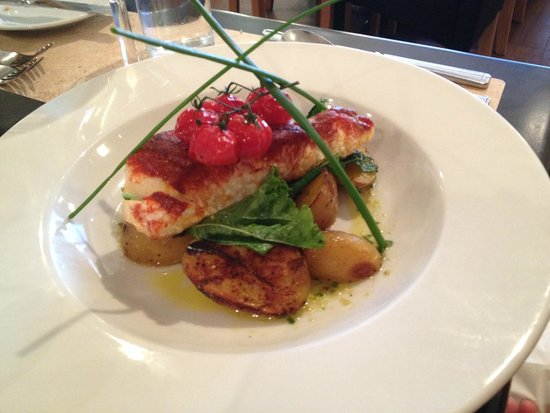 The Riverside Restaurant : Smoked paprika North Sea Cod loin on sautéed potatoes with rocket pesto dressing