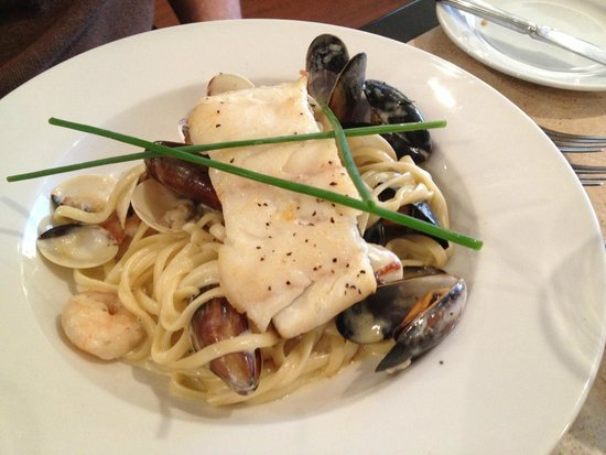 The Riverside Restaurant : Wild Halibut Fillet served on linguine pasta with king prawns, West Coast mussels & surf clams