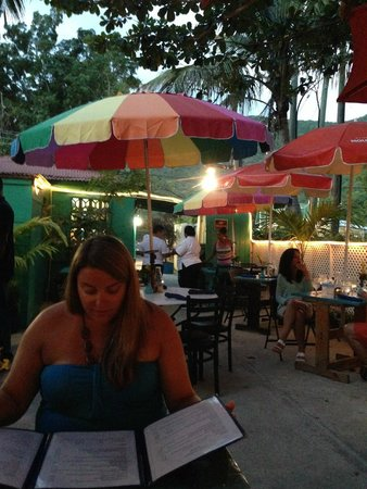 D Coalpot BVI Restaurant Bar & Grill: Looking at Menus on Back Garden Patio