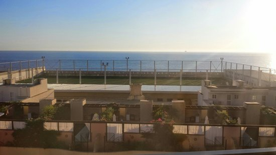 Fortina Spa Resort : View across to the sea from an 8th floor balcony.  Shame about the football pitch as it rather s