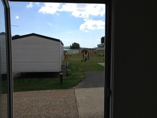 Nodes Point Holiday Park - Park Resorts: Chalet view over playpark