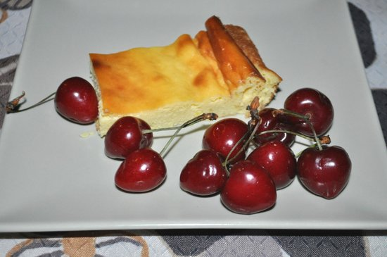 A Casella: A typical Corsican Brocciu cheesecake, with fresh cherries.