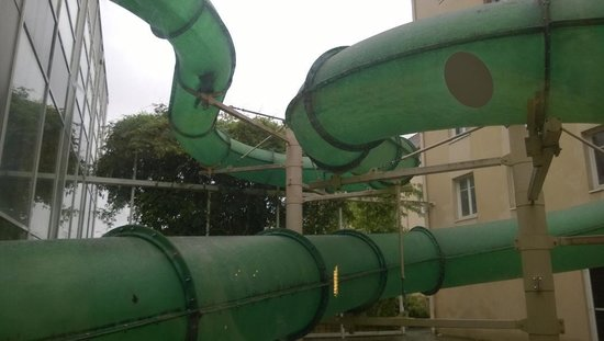 Explorers Hotel: The big water slide goes out of the indoor pool from the top and back inside.