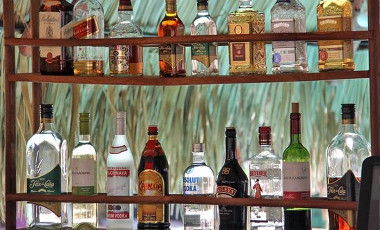 Surf Ranch Hotel & Resort : Alcohol rack at the bar