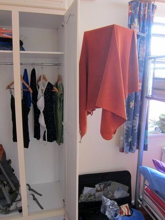 The Hideout Hostel : Wardrobe (!!) and corner of window.