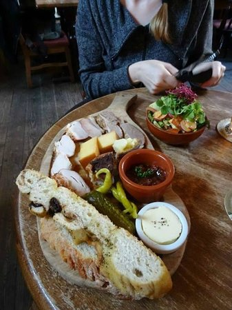 House of the Trembling Madness: madness platter (smoked chicken and duck, cheese, hot peppers, salad, bread, and plum chutney)