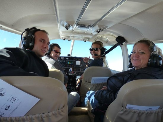 Stampede Aviation: Satisfied passengers and a pretty cool pilot.
