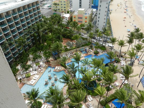 San Juan Marriott Resort & Stellaris Casino: View from side balcony of city, pool and ocean