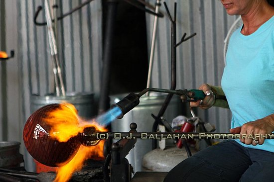 Morean Art Center: Oven and blast furnace are aided by a hand held torch in shaping the glass