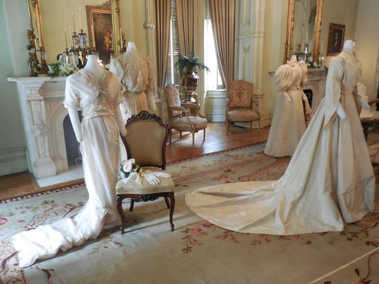 Woodruff-Fontaine House: Sample period wedding dresses displayed in the front sitting room