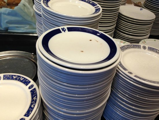 Rodos Palace: Filthy plates waiting for the guests at breakfast - notice none of the plates are of the same de