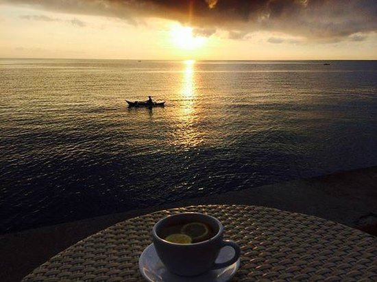 Danao Coco Palms Resort : Awesome sunrise over a cup of honey lemon