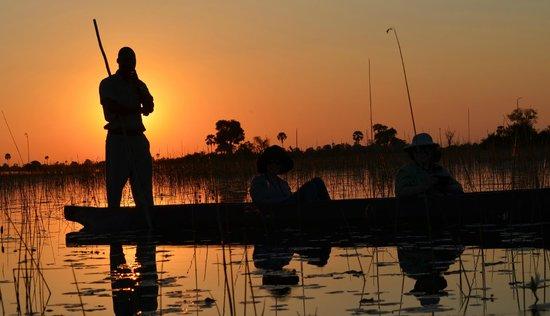 andBeyond Nxabega Okavango Tented Camp : Mokoro boat ride at sunset