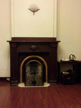 Taj Savoy Hotel, Ooty: Fireplace