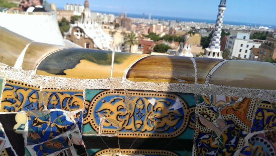 Parc Güell : Gaudi mosaic benches with Barcelona skyline in the background