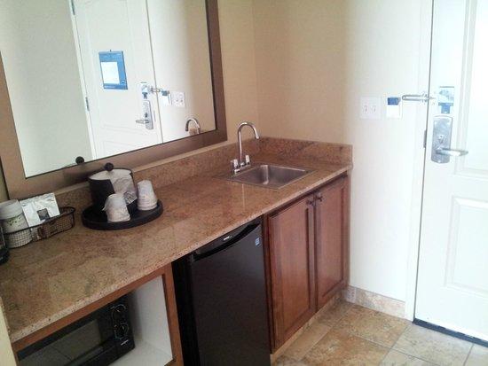 "Hampton Inn & Suites Fargo: ""kitchen"" area and entry area of room (#303)"