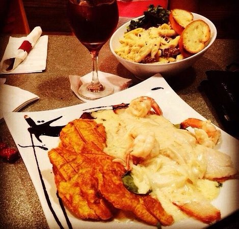 Francachela Aguadilla : Penne Pasta with Skirt Stake and Fish Fillet With Shrimp with three cheese Sauce!!! Delicious.